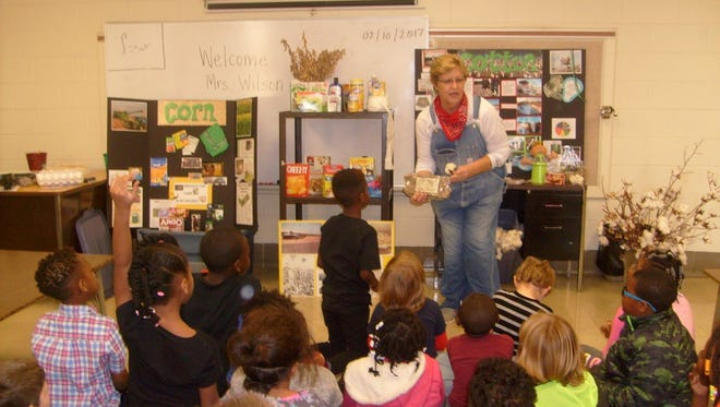 """John C. Calhoun Elementary School's K5 and first-grade classes get a visit from Carol Wilson, """"The Farm Lady."""" The students got a kick out of learning where some food comes from, and cotton to make the clothes they wear."""