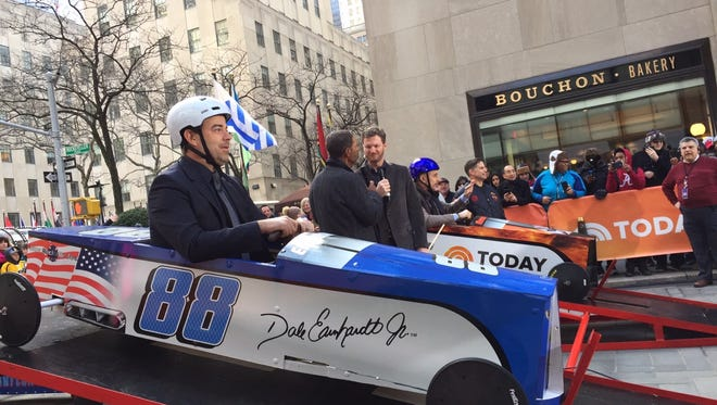 New Rochelle's firefighters brought soapbox cars to Manhattan to be used by The Today Show with Carson Daly (front), Dale Earnhart, Jr. and Matt Lauer (back) in Manhattan Feb. 21.