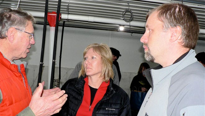 Bob Pofahl (left) and Dan Wierzba of Middleton -based Resource Engineering Associates talk with Tammy Vaassen, Executive Vice-President of the Wisconsin Pork Producers.