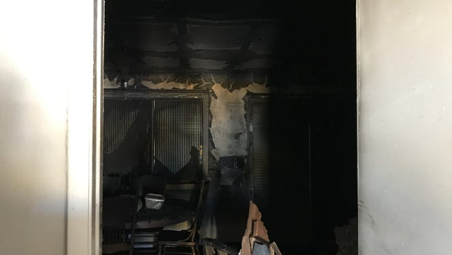 Phoenix firefighters say they found the body of a 30-year-old man when they were called to a house fire in Phoenix on March 10, 2017. The picture is a view from the carport into the kitchen area.