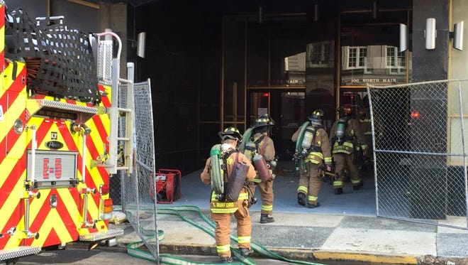 Memphis Fire Department crews respond to a blaze at 100 N. Main on Wednesday.