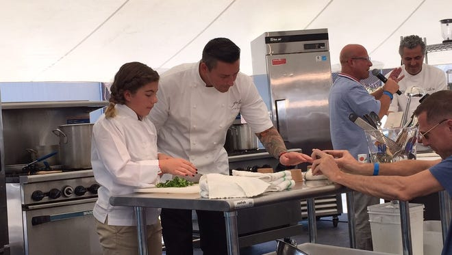 Fiona Baulo, winner of the 2016 Healthy Lunchtime Throwdown, and Michelin starred chef, Curtis Duffy, cook during the cook-off event at Euphoria in September 2016.
