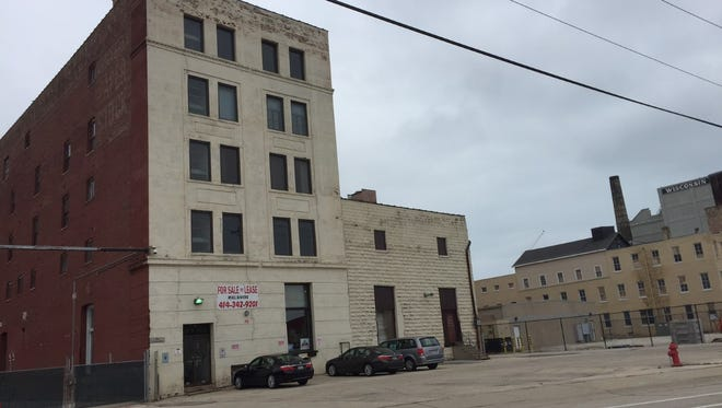 A five-story industrial building in Walker's Point might be converted into 110 apartments.