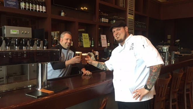 "Head brewer Josh Ervine (left) and Head Chef Scot Seher Jr. toast their upcoming ""Edgy & Veggie'' beer pairing dinner at Iron Hill Brewery in Maple Shade."
