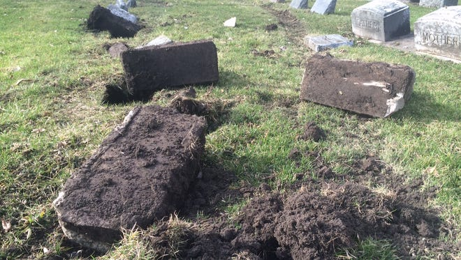 Headstones at Oshkosh's Riverside Cemetery were likely damaged by a vehicle. About 10 markers were damaged, and tire tracks left ruts in nearby grave sites.