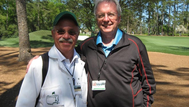 Former Argus Leader sports editor Wade Merry (right) poses with Masters caddy and friend John Schleich at Augusta National Golf Club. Merry has been covering the event for 23 years.
