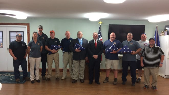U.S. Rep. Jeff Duncan presented flags that flew over the U.S. Capitol to firefighters and other emergency personnel who responded to last year's shooting at Townville Elementary. School. The event happened Tuesday at the Townville fire station.