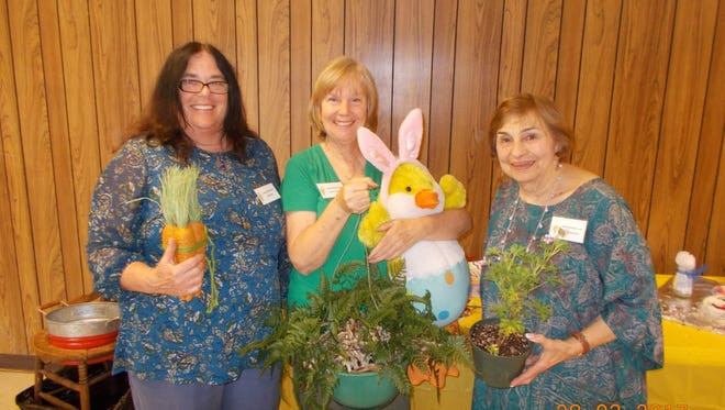 Judy Rains (left), Susan O'Connell with rabbit foot Fern she won but will donate to the Spring Festival fundraiser for the Lavonia Garden Club and Carol Ann Davis