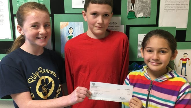 Shown are Blue Ridge Elementary School fifth-grade Gifted/Talented (GT) English/Language Arts students Mallie Merck, Daniel Brettin, and Vanessa Bravo who wrote letters to Ulbrich Specialty Wire Projects.