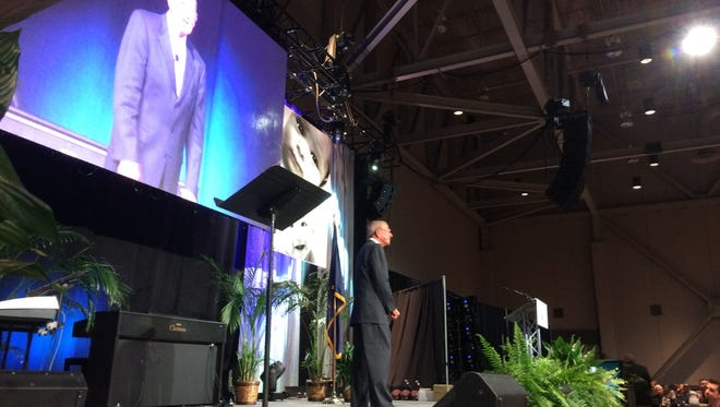Former Notre Dame football coach Lou Holtz speaks at the Right to Life banquet at The Old National Events Plaza Thursday.