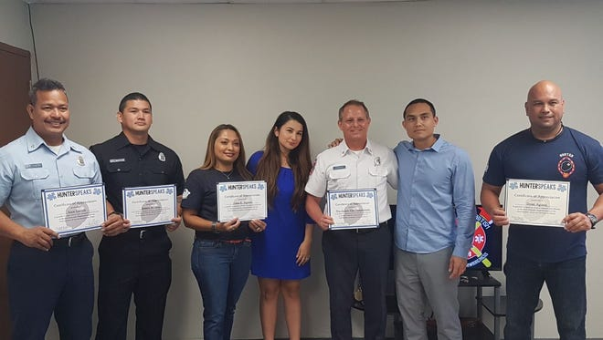In this April 15 file photo, HunterSpeaks Organization founders Dr. Vinny Duenas and his wife, Tanya Duenas, present Guam Fire Department with certificates of appreciation. A boot drive on April 28 will   benefit the HunterSpeaks.