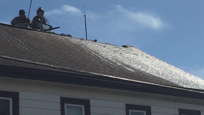 Fire fighter cut ventilation holes into a roof after an attic fire at 162 W. Main St. in Jonestown Friday afternoon.