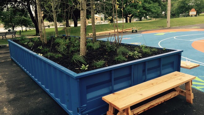 Large planting containers and benches adorn the RiverPlay pop-up park on Riverside Drive.