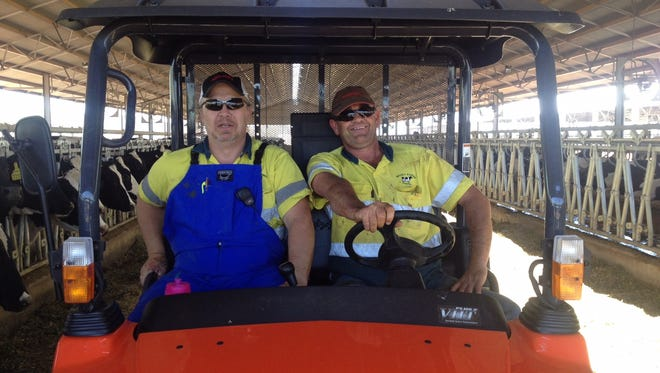 """""""Cows are cows, no matter where you go,"""" says dairyman and global consultant Jim Van Patter (left)."""
