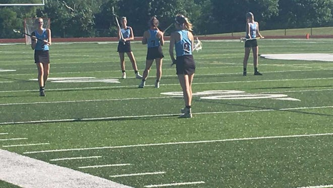 No. 4-ranked Okemos girls lacrosse fell to No. 1-ranked Cranbrook Kingswood, 14-8, in Wednesday's Division 2 state semifinal game at Novi High School