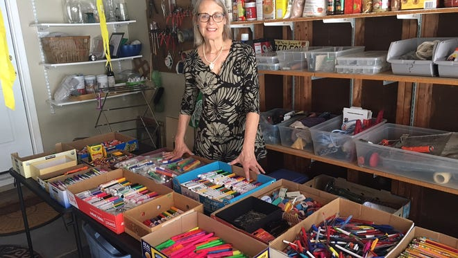 Sky McClain, a retired school teacher, stands inside the garage of her Moorestown home where she organizes an annual school supplies giveaway from used and recycled supplies that were destined for the trash.