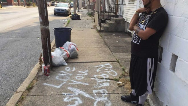 Brandon Groff-Wood, 32, stands near a memorial in the 500 block of West Philadelphia Street for Angel Hernandez, 20, of York, who police say was shot in the back there just after 4 a.m. Sunday.