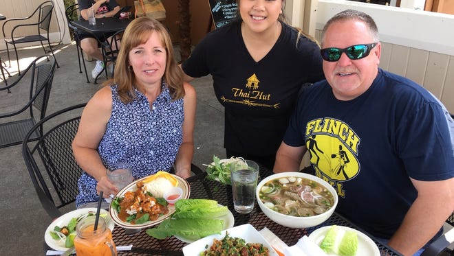 Server CoCo Saetern with Jeff and Delaine Smith at Thai Hut.