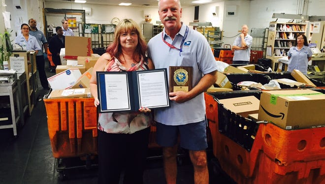 Budd Lake Postmaster Melody Baylis recognized Letter Carrier Bob Peterson with a special certificate and a letter of appreciation.