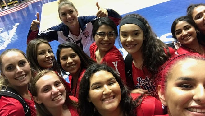 Members of the Indio girls' volleyball team pose with Team USA star Lauren Carlini during a trip to see USA play brazil.
