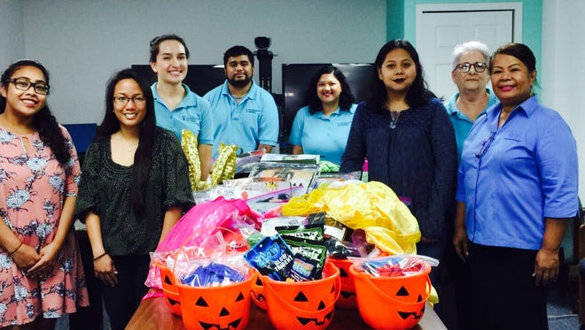The Pacific Daily News employees collected used Halloween costumes in partnership with the Guam Coalition Against Sexual Assault and Family Violence to benefit member organizations. Pictured from left: Yoni Towai and Aurea Tagudin of the Catholic Social Service/Alee Women and Children's Shelter; Taylor Amdal-Barela, Hage-Ae R. Paul and Francesca Gatuz of the Guam Coalition Against Sexual Assault & Family Violence; Michelle Barcinas of Erica's House; Sheri Batungbacal of the Guam Coalition Against Sexual Assault & Family Violence and Doris Royal of Kamalen Karidat. PDN will continue to accept donations until Oct. 20, 2017.