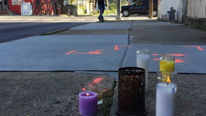 Candles set up in memory of Ce'onty Robinson, 17, who was fatally shot Saturday night at the intersection of South Pen Street and West College Avenue in York.