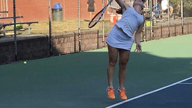 Senior Anna Brylin prepares to serve against Newark Academy.