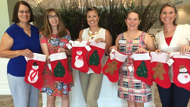 Santa's Elves are busy preparing to make the holidays brighter for abused children at the Hibiscus Shelter.  From left, meet  elves Mary Zottoli, Kary Prueger, co-chairs Heidi Monsour and Ellen Houts, and Michelle Schwartz.