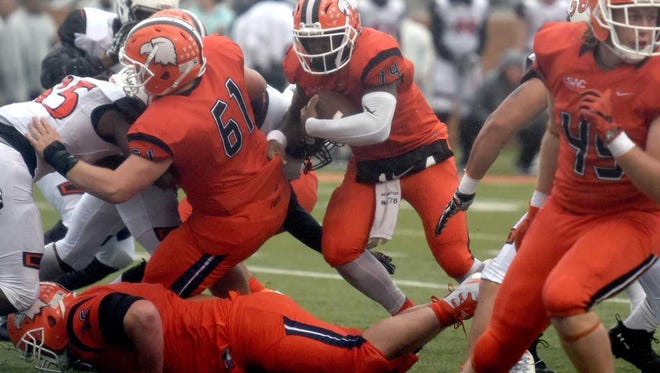 Carson-Newman quarterback Derek Evans scores a touchdown in the second quarter against Tusculum College at Burke-Tarr Stadium in Jefferson City on Saturday.
