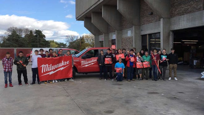 Menomonee Falls High School students in Bret Warner's Technology Education class pose with $6,000 worth of tools donated by Milwaukee Tool.
