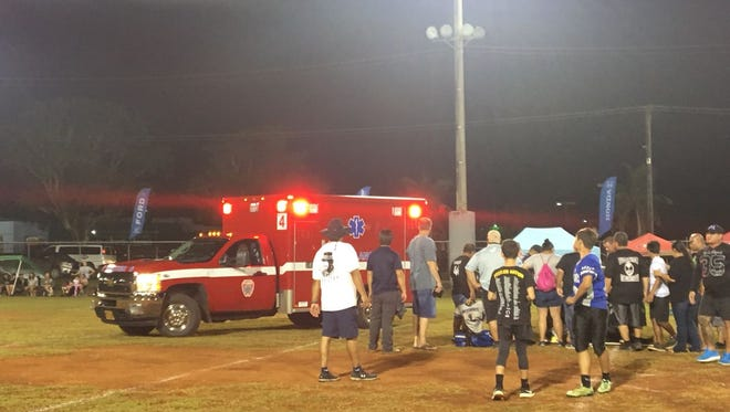 An ambulance on the scene at Angels Field in Dededo. Medics were attending to GW football player Keanu Salas, who was injured during the Triple J High School Football All Stars game. The Mustangs beat the Raptors 27-19.
