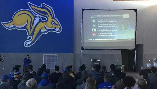 SDSU players watch their team announced as the 5-seed in the FCS playoffs