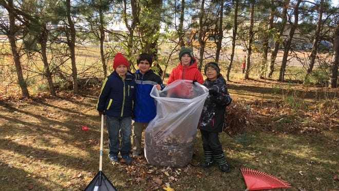 Hatley Elementary students raked leaves for some of their neighbors earlier this month.
