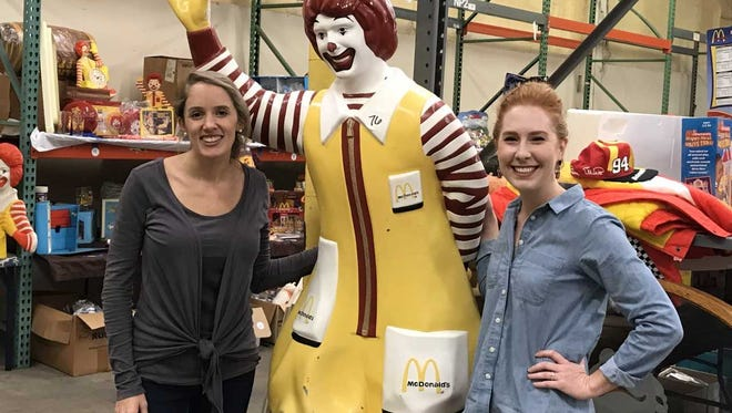 From left, Lauren Stimmell, Ronald McDonald House Charities of Northwest Florida event manager, and Ashley Gillis, the organization's community relations manager, pose with a Ronald McDonald that will be auctioned Dec. 9, 2017, to benefit the organization.