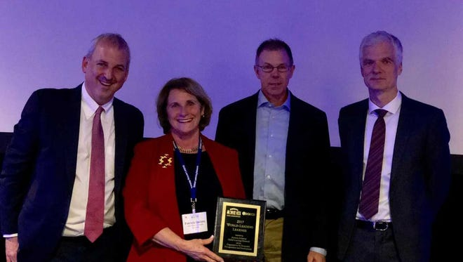 From left to right: Principal Stephen Plum and Superintendent Pat Deklotz accept an award from Andreas Schleicher, Director for Education and Skills and Special Advisor to the Secretary-General of the OECD , and Jon Schnur, Executive Chairman of America Achieves.