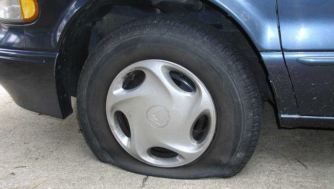 Stock image of a flat tire.