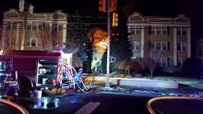 Officials are investigating the cause of a five alarm fire in a Summit Avenue apartment building that left 15 families displaced.