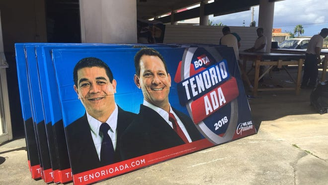 Campaign signs promoting the 2018 gubernatorial run of Lt. Gov. Ray Tenorio and running mate Tony Ada under construction in Maite.