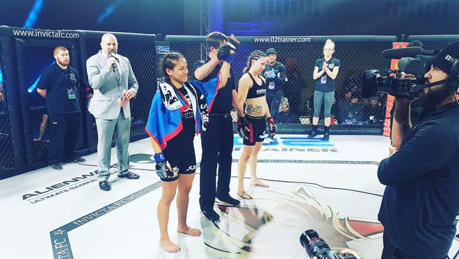 Brogan Walker-Sanchez, left, is announced the winner over Cheri Muraski by split decision on Saturday night at Invicta FC 27 in Kansas City, MO.