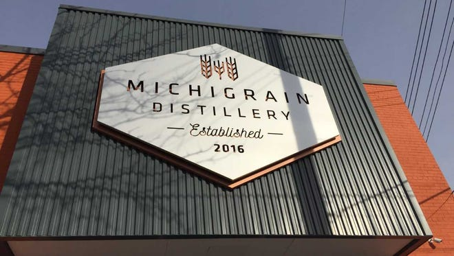 Michigrain Distillery's sign on Jan. 19. The distillery has a tasting room and sells bulk spirits to other distilleries in the state.