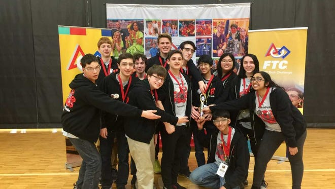 Homestead High School's Kraken Pinion FTC Robotics team won the Northwestern Indiana Regional competition, at which it set several scoring records that pushed it to the first-place world ranking.