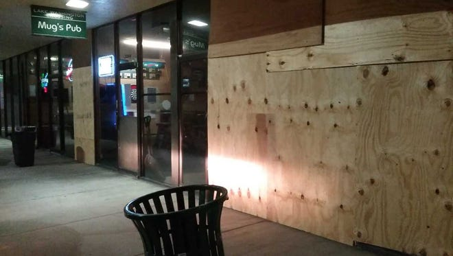 A car drove through the front window of Mug's Pub on Lake Washington Rd. in Melbourne on Thursday night.