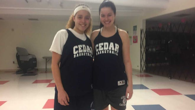 Azelyn Arenas. left, and Carly Sanders, the only two seniors on the Lebanon High girls basketball team, helped the Cedars end a 41-game losing streak on Wednesday night.
