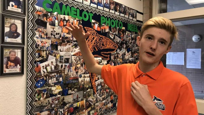 Aubrey Lister, a senior at Camelot Academy, points out his picture on a school photo board on Friday, Feb. 23, 2018.