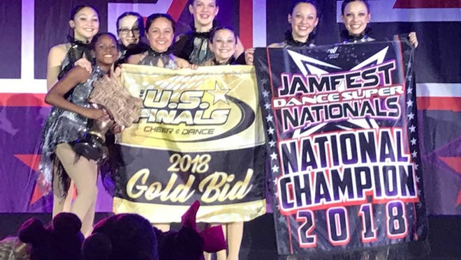 The Starlites dance team poses for a photo at the Jamfest Dance Super Nationals in St. Louis.