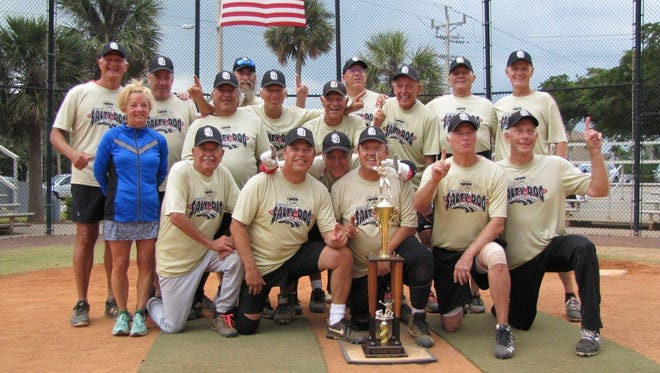 Salty Dog Marco Division Championship Team. Standing, left to right: Coach Rob Mann, Statistician Sheri Mann, Bob Traver, Jan Grossman, Coach Dan Marinelli, Angelo Polizzi, Joe Cervelli, Pat Comerford, Ralph Leiterding, Assistant Manager Ron Irwin and Gary Grefer. Kneeling, left to right: Ray Zielinski, Geoff Bentley, Manager Tom Loiacono, George Lancaster, Larry Wildes and Pat Romzek.