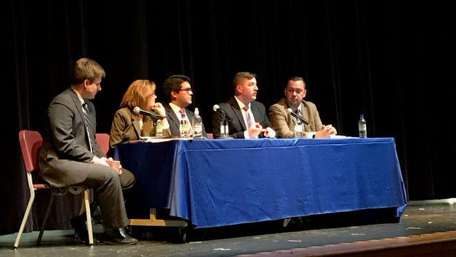 A panel of politicians debates gun control and the rights of gun owners during a panel discussion at Middletown High School on April 16. Pictured are (from left) moderator Matthew Albright; Kathy Jennings, a Democratic candidate for Delaware Attorney General; state Sen. Anthony Delcollo, R-Christiana; state Sen. Bryan Townsend, D-Newark; and state Sen. Brian Pettyjohn, R-Georgetown.