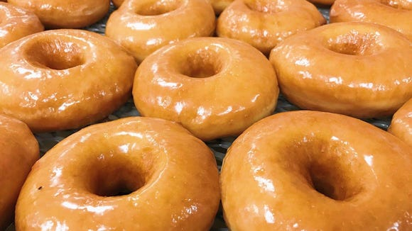 A batch of glazed doughnuts are pictured at Rickey Meche's Donut King.