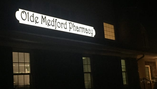 Authorities say a pill mill operated from the Olde Medford Pharmacy on Stokes Road.