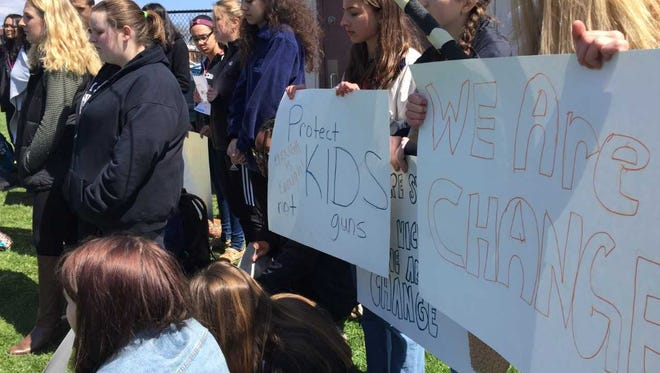 Students at York Suburban Senior High School gathered on their lunch break to join the national protests among students calling for stricter gun laws in the wake of school shootings.